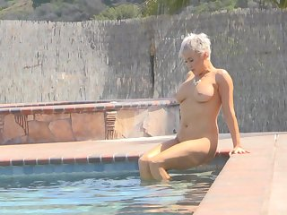 Ryan exposes her huge tits and takes a naked swim in get under one's pool