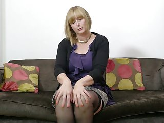 Grown up auburn lady April is really into working on her wet pussy