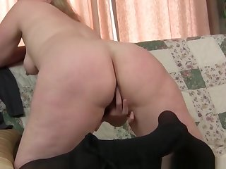 Mom's pantyhosed pussy gets her on a high with the addition of horny