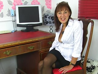 Georgie strips and fingers her hairy pussy up ahead office