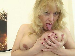 Fair-haired grown up amateur British granny Lucy Gresty masturbates