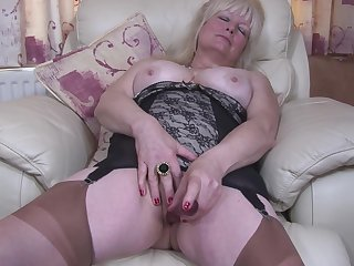 Buxom amateur adult British granny Cindy S. masturbates in pantyhose