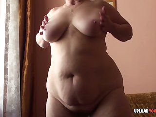 Granny with big boobs displays her body