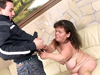 Mature Beldam Lola likes to light of one's life with her young neighbor without mercy