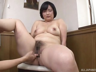 Japanese mature works young inches in both her hairy holes