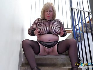 Mature lady took elevation advantage of the stairwell not later than her toy masturbation
