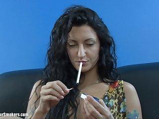 Matured brunette with long hair smoking before masturbating passionately