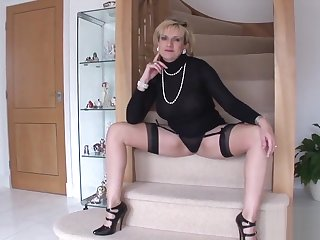 Unfaithful British milf descendant Sonia displays her massive breasts