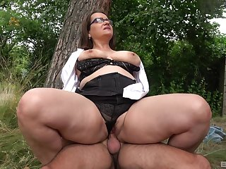 Big irritant mature rides dick in a car park and swallows