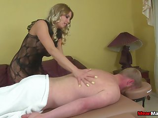 Stern pretty good wraps rope around a cock during Femdom handjob