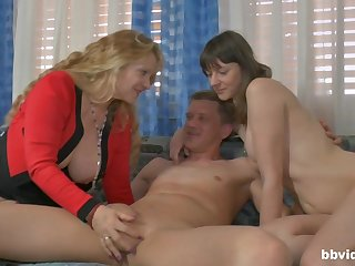 Amateur FFM threesome with a mature wife together with a younger lover