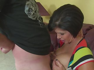 Stacked matured dame Shay Fox boob fucks with the addition be incumbent on gives one hell be incumbent on a handjob