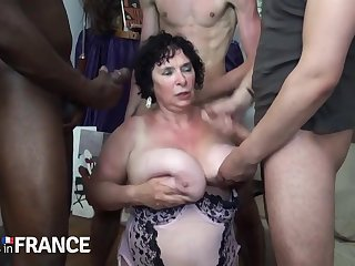 Horny granny fucked by two unafraid young guys
